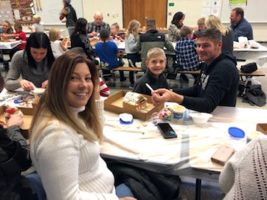 First Graders Build Gingerbread Houses with Families